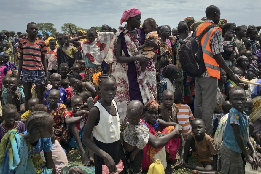Men, women and children line up to be registered with the World Food Programme in South Sudan. South Sudan no longer has areas in famine, but almost 2 million people are on the brink of starvation. (Sam Mednick/AP)