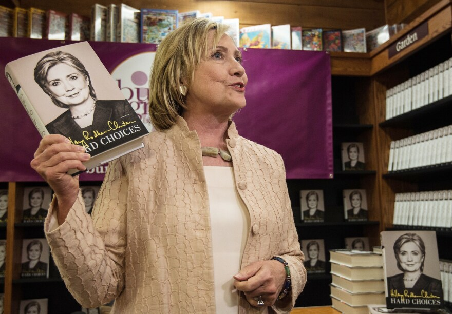 """Hillary Clinton arrives to sign her book """"Hards Choices"""" at a bookstore on Martha's Vineyard on August 13, 2014. According to the Clintons' 2015 tax returns, the couple earned $3.1 million from book advances and royalties."""
