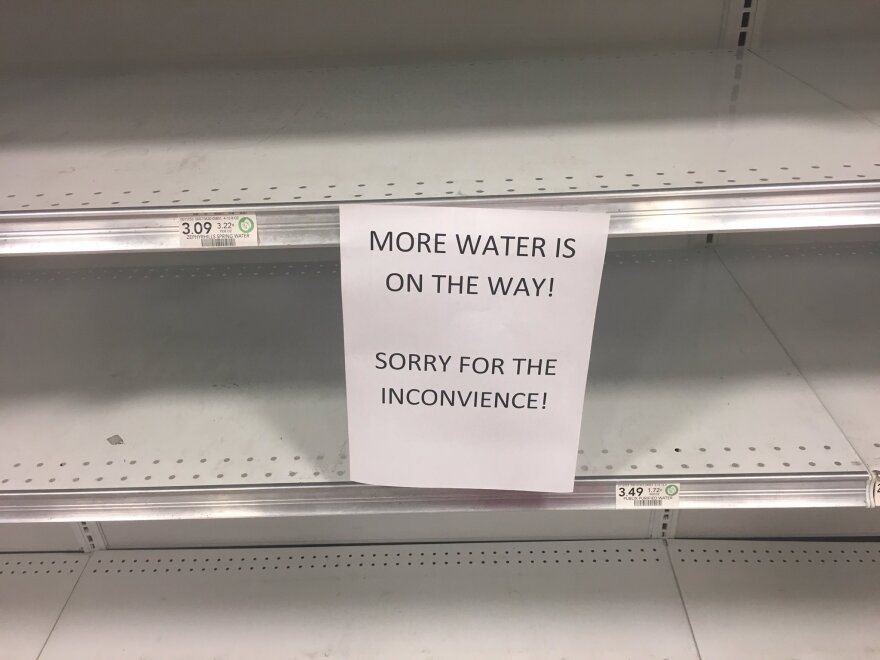A Publix grocery store in downtown Tampa struggles to keep bottled water on the shelves as residents prepare for Hurricane Irma.