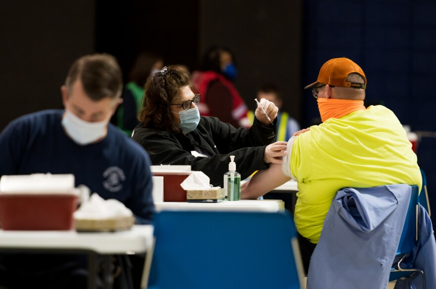 St. Louis County workers are vaccinated with the Pfizer vaccine at the mass vaccination site located on the campus of St. Louis Community College - Florissant Valley.