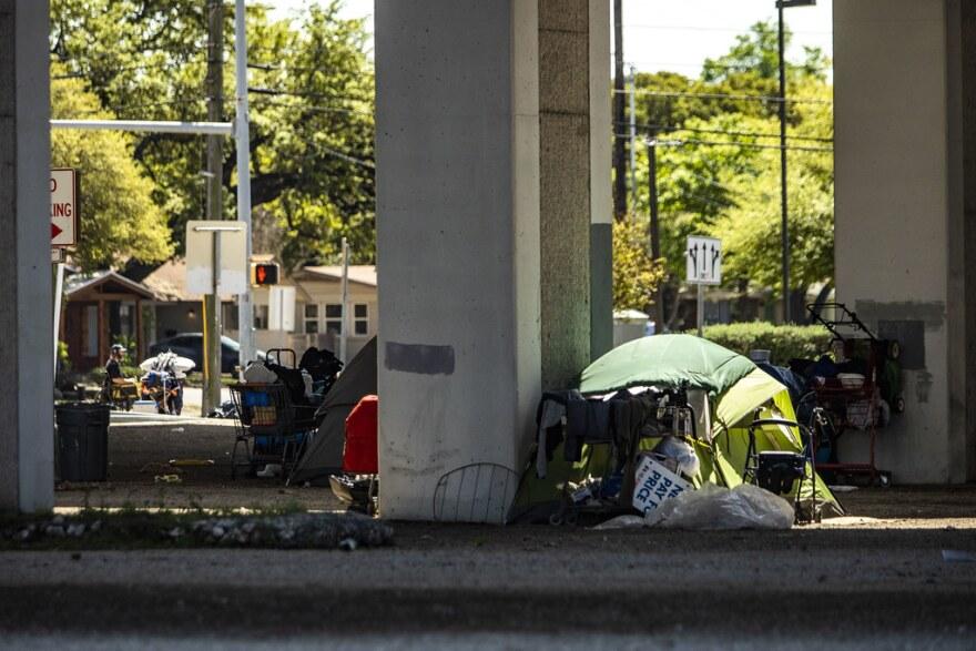 A homeless encampment set up under Ben White Boulevard.