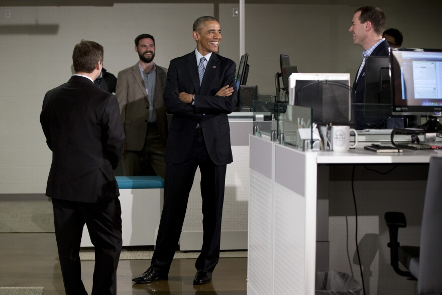 President Obama tours the Louisville-based tech company Indatus with Indatus president Philip Hawkins (left).