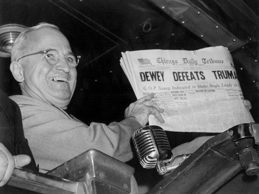 """Former President Harry Truman holds up an Election Day edition of the Chicago Daily Tribune, which, based on early results, mistakenly announced """"Dewey Defeats Truman"""" on Nov. 4, 1948."""