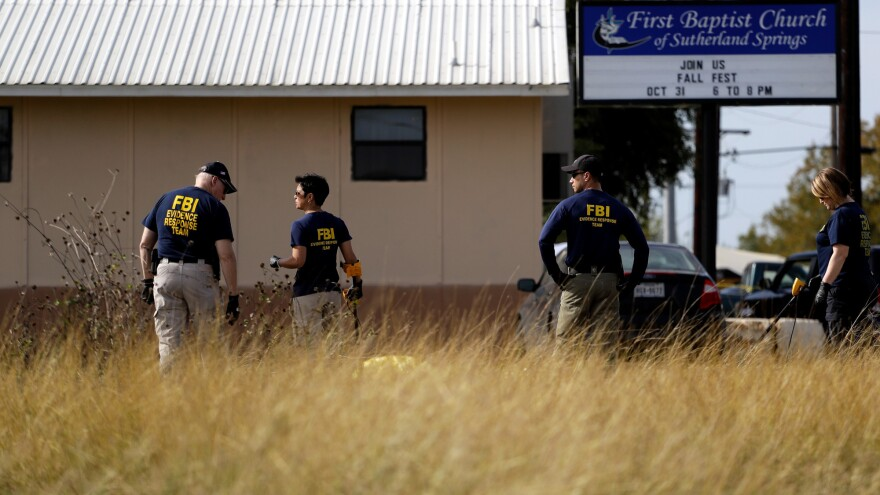 Law enforcement officials investigate the scene of a shooting at the First Baptist Church of Sutherland Springs, Texas, earlier this week in which 26 people were killed.