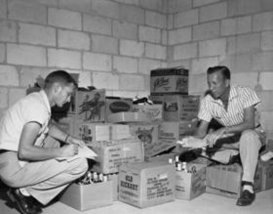 Florida beverage agents taking inventory of confiscated liquor in 1957.  The state has long kept a tight grip on alcohol, but regulations are beginning to loosen.