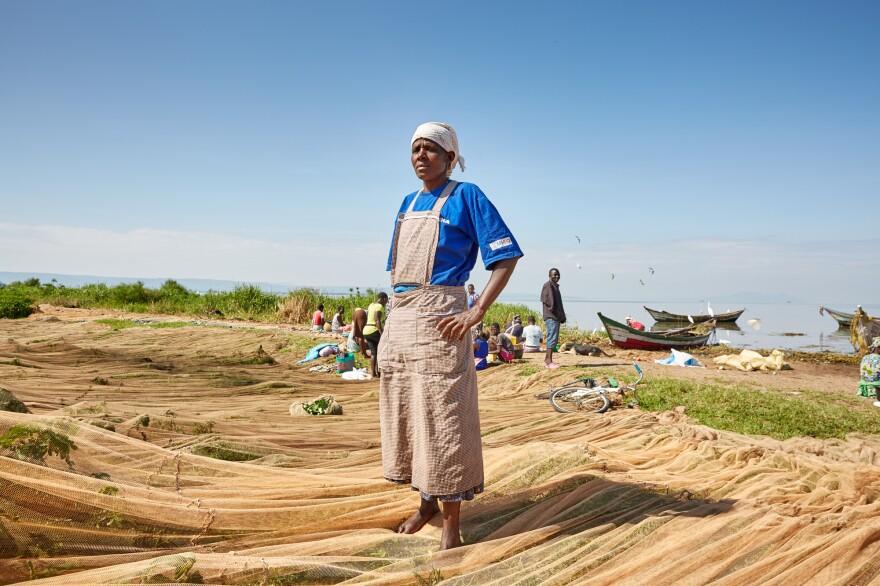 Milka Onyango stands on the fishing nets strewn across Nduru Beach in November 2019.