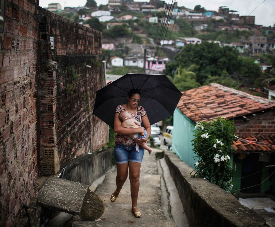 Mylene Helena Ferraira of Recife, Brazil, carries her 5-month-old son, David Henrique Ferreira, who was born with microcephaly. She's returning home after a medical visit.