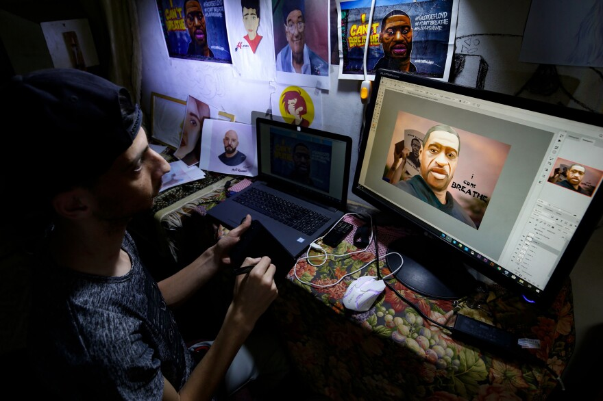 Palestinian digital artist Munes al-Salihi draws a portrait of George Floyd at his house in a refugee camp in the Gaza Strip on June 4.