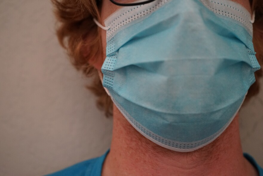 A photo of a man wearing a face mask.