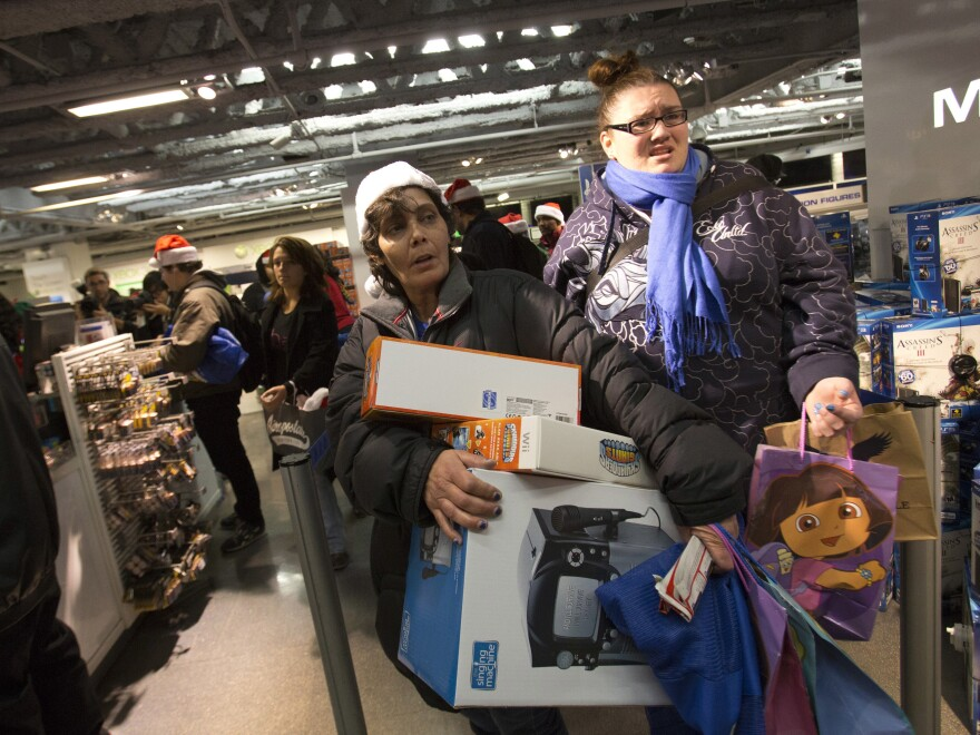 """People line up to purchase items at the """"Black Thursday"""" sale at the Toys 'R Us store in Times Square on Nov. 22, 2012, in New York City. The store got a head start on the traditional Black Friday sales by opening their doors at 8 p.m. on Thanksgiving night."""