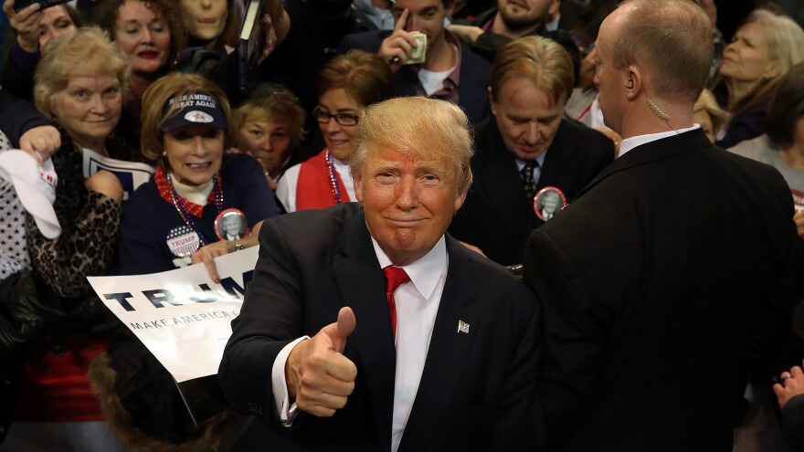 Trump pauses with supporters after speaking at the Mississippi Coast Coliseum on Jan. 2, 2016, in Biloxi, Miss.