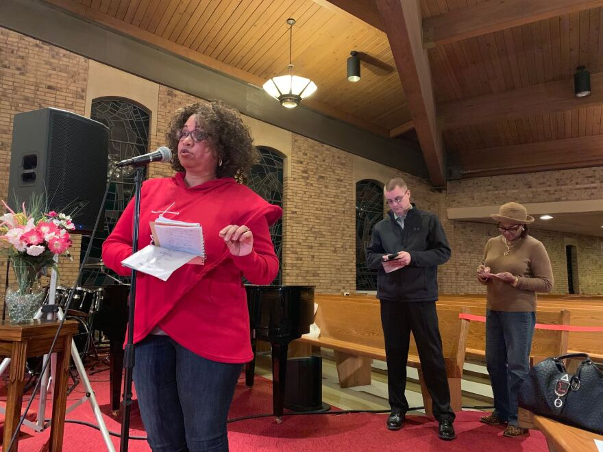 Gail Woods (left) and others attend the Better Together Town Hall at Greater St. Mark Family Church. The event is one of several town halls that will be hosted by the organization.