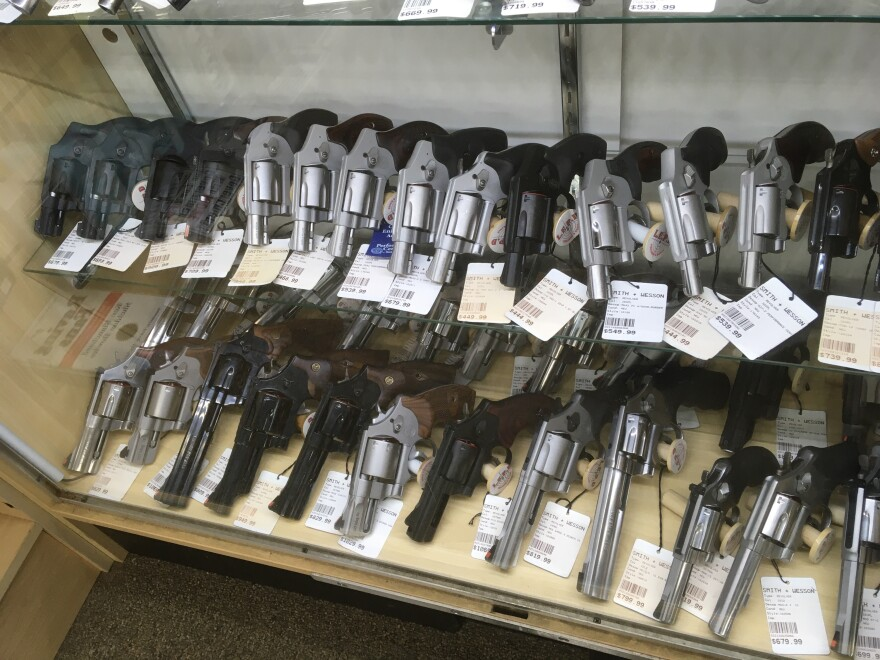 rack of revolvers at gun shop