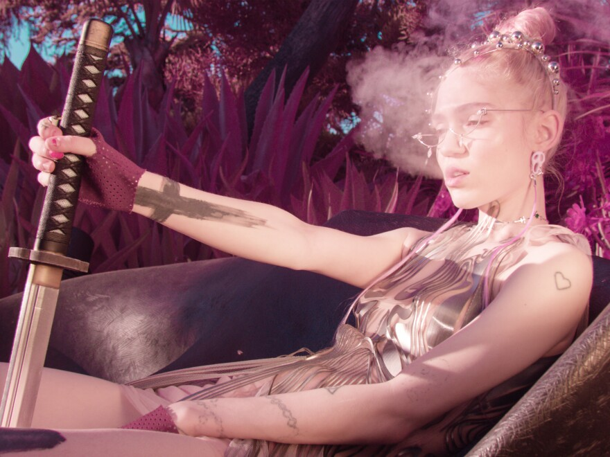 Grimes' fifth album, <em>Miss Anthropocene</em>, pushes the pleasure buttons of mainstream pop while also appearing to critique it.