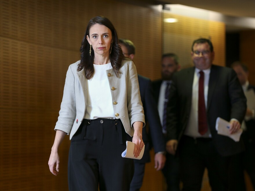 "New Zealand Prime Minister Jacinda Ardern arrives for a press conference Friday in Wellington. A new coronavirus outbreak has grown to 30 cases, and Ardern predicts of the cluster, ""It will grow before it slows."""