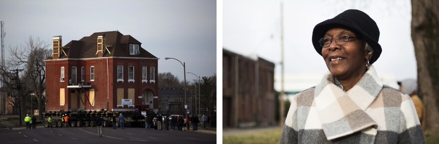 Charlesetta Taylor watches as workers move her home from Market Street to St. Louis Avenue on Feb. 26, 2017.