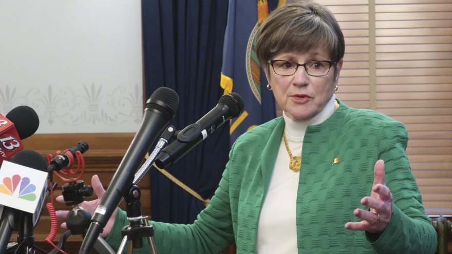 Kansas Gov. Laura Kelly addresses a news conference Tuesday in Topeka, Kan., after announcing the closure of K-12 schools throughout the state for the rest of the school year.