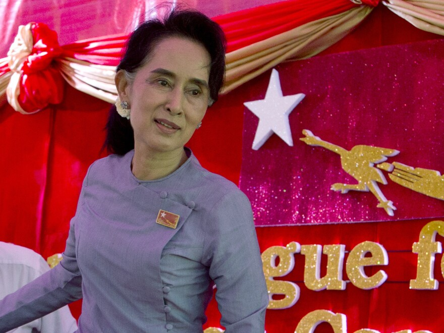 "Myanmar's opposition leader Aung San Suu Kyi says she will be ""above the president"" if her party wins Sunday's election. In a constitutional clause that appears directed at her, a person can't become president if he or she is married to a foreign national or has children who are foreign nationals. Suu Kyi's late husband was British, as are their two sons."
