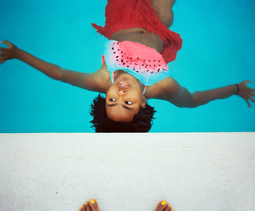 Thandi floating in the pool.