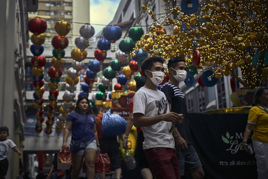 Shoppers wearing face masks for protection in Chinatown on January 23, 2020 in Manila, Philippines.