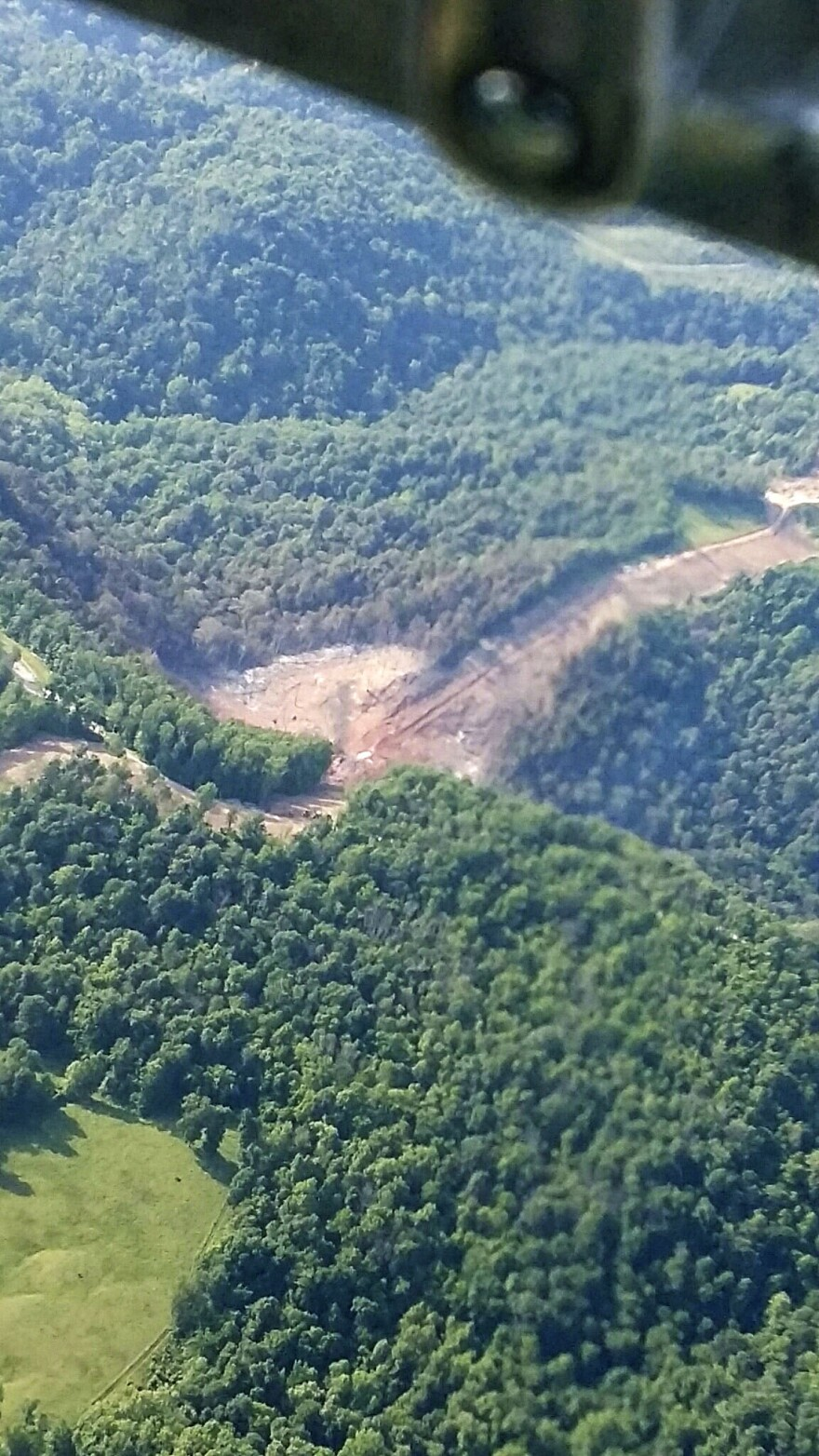 A crater in the earth following a Marshall County natural gas pipeline explosion as seen from the air.