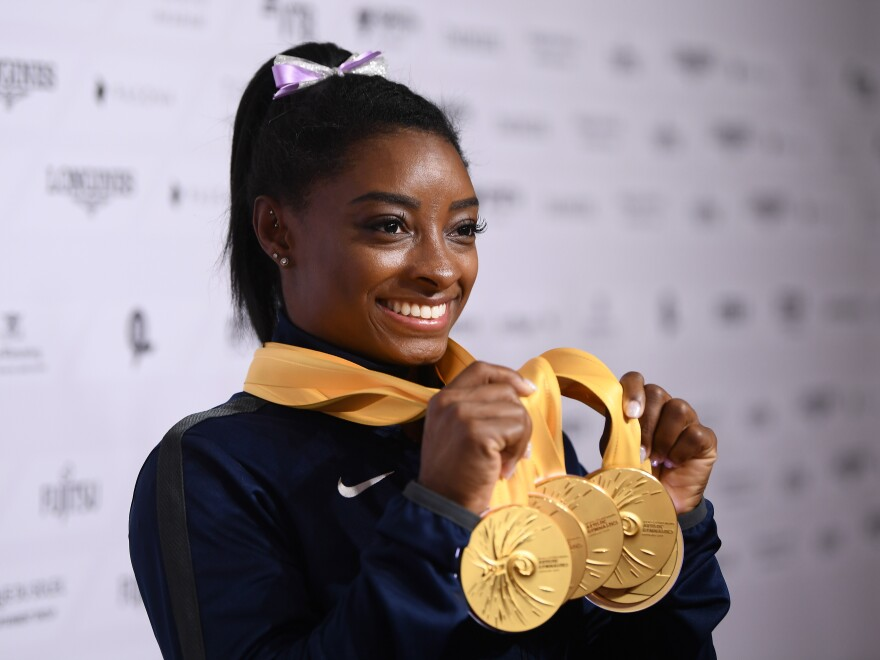 U.S. gymnast Simone Biles poses with her five gold medals at the 2019 World Championships in Stuttgart, Germany. With her wins, she becomes the most decorated gymnast ever at the world championships, with 25 total medals.