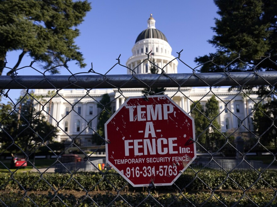 A temporary six-foot high chain link fence surrounds California's state Capitol because of concerns over the potential for civil unrest.