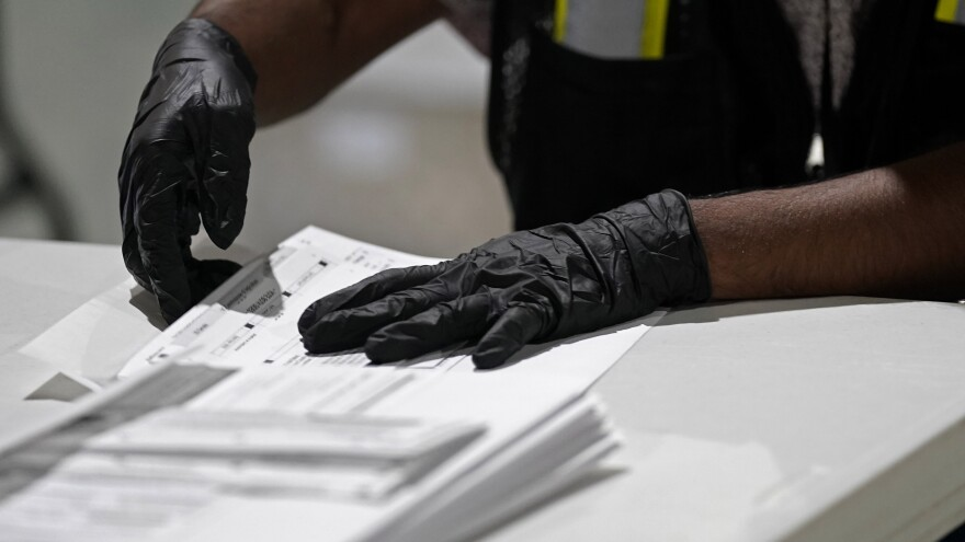 A worker prepares absentee ballots for mailing at the Wake County Board of Elections in Raleigh, N.C., earlier this month.