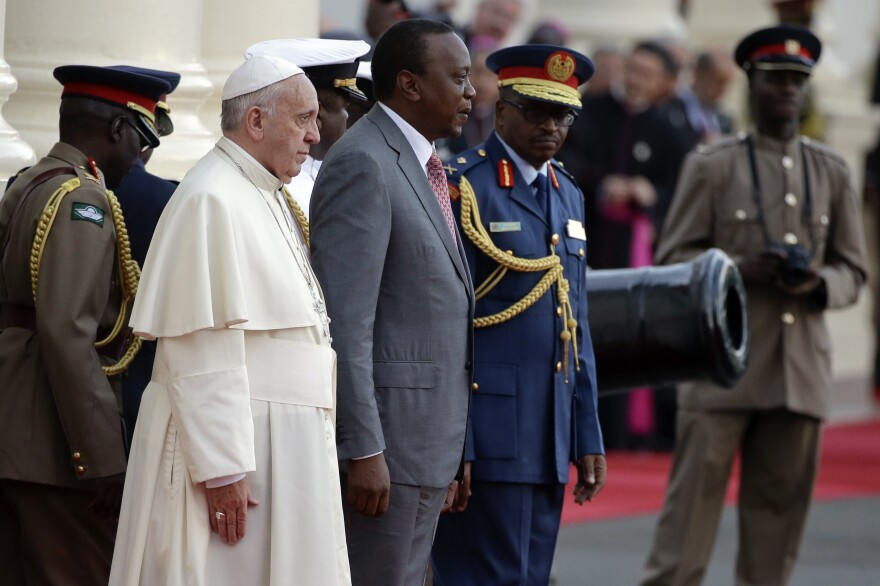 Pope Francis is greeted by Kenyan President Uhuru Kenyatta upon his arrival at Nairobi's State House on Wednesday.