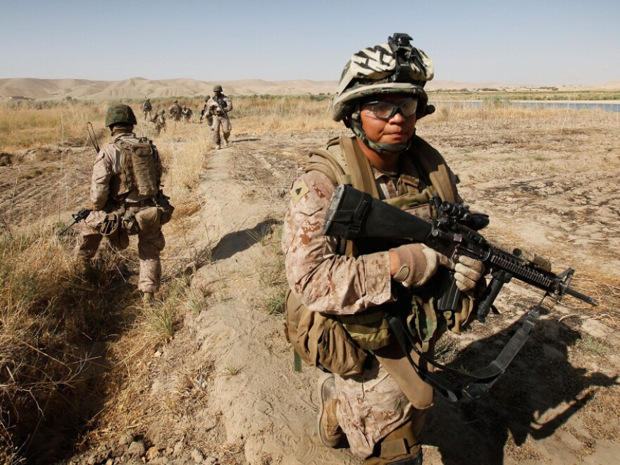 <p>Cpl. Marcus Chischilly patrols near Forward Operating Base Zeebrugge in October 2010, near Kajaki, Afghanistan. This photo was taken a day before he stepped on an IED, losing his left leg and suffering other shrapnel damage.</p>