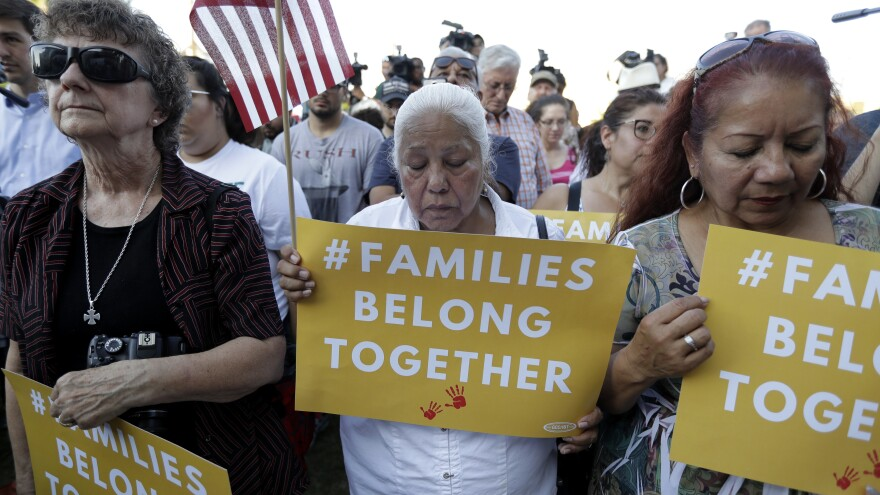 "Protesters in San Antonio pray during a Rally For Our Children event to protest the Trump administration's ""zero-tolerance"" immigration policy."