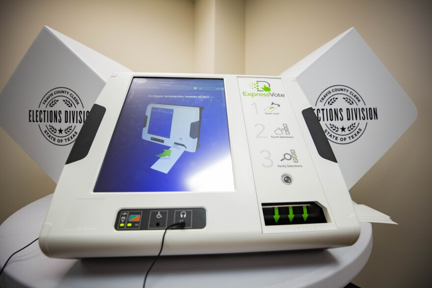 The new voting machines in Travis County produce a marked paper ballot. Voters scan and drop the ballot into the ballot box before they leave the voting center.