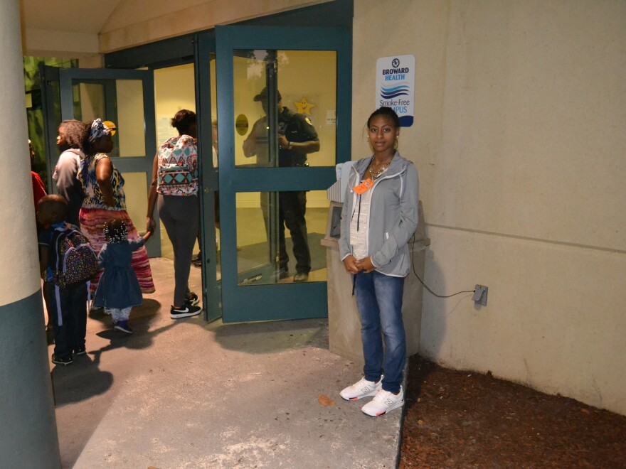Porcha McIntosh waits outside the door of the emergency room at Broward Health Medical Center in Ft. Lauderdale on Feb. 14. For hours she wasn't able to get inside to be with her newborn, who was in the neonatal intensive care unit.