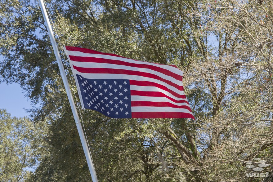 The flag upside-down and at half-staff at Robin Koon's home