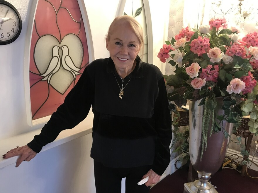 "Charolette Richards, 83, is the owner of A Little White Wedding Chapel. She's been marrying people for some 60 years. Las Vegas has never been Sin City to her, she says. It's ""love, love, love."""