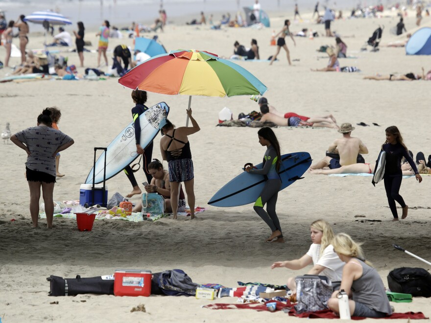 On Thursday, beachgoers flocked to Huntington Beach. California Gov. Gavin Newsom announced that same day he was ordering all Orange County beaches to close, after tens of thousands gathered at the shore last weekend.
