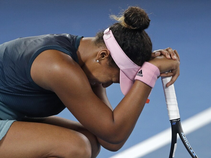 Japan's Naomi Osaka reacts to her victory over Petra Kvitova of the Czech Republic in the women's singles final at the Australian Open tennis championships in Melbourne.