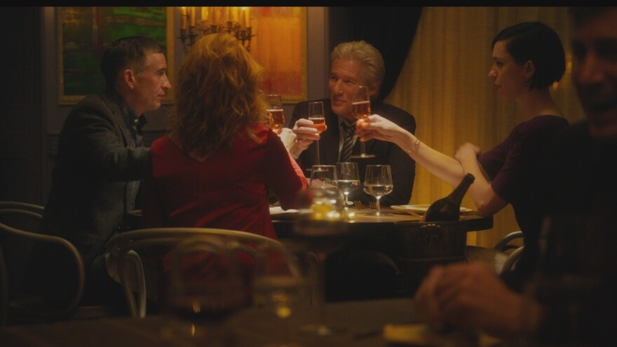 """""""Go on, do your Michael Caine!"""": Paul (Steve Coogan), Claire (Laura Linney), Stan (Richard Gere) and Katelyn (Rebecca Hall) get toasted in <em>The Dinner</em>."""