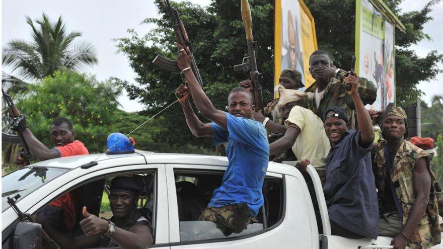 Soldiers loyal to Ivory Coast's president-elect, Alassane Ouattara, celebrated in a district of Abidjan after the arrest Monday of strongman Laurent Gbagbo.