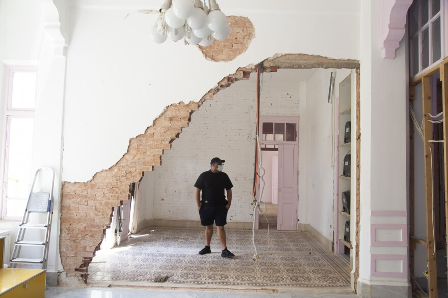 """Eli Rezkallah, owner and founder of Plastik Studios, walks around his office in the neighborhood of Gemmayzeh. """"To me <em>Plastik</em>'s mere existence was to add colors and light to a war-torn city."""""""