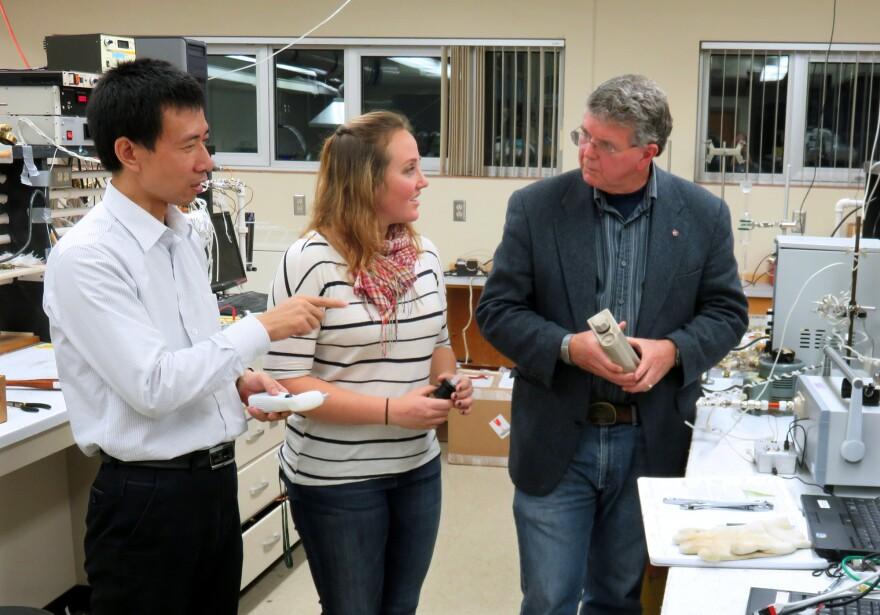 Research professor Wenjie Liu works with graduate student Jennifer Tufariello and professor Herb Hill to develop a marijuana breath test at Washington State University.