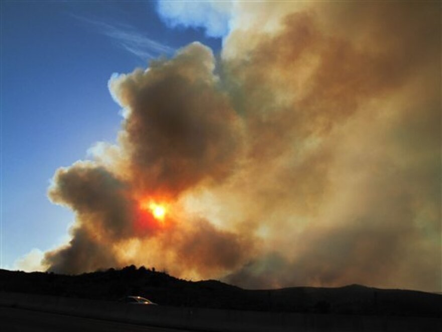 A fire blazes in Arizona's Tonto National Forest, near Payson, Ariz., on May 12, 2012.