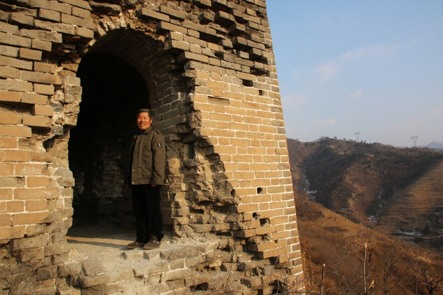 Qiao Guohua, a resident of Jielingkou village, is paid a small sum of money by the local government to patrol a section of the Great Wall. He's come to know every feature of the wall and its surrounding landscape intimately.