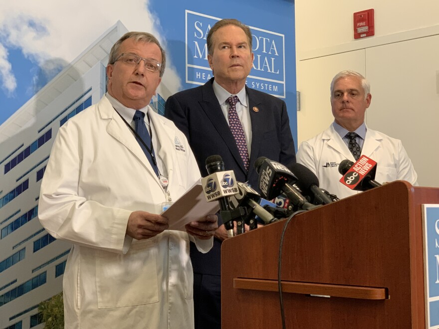Sarasota Memorial Hospital chief medical officer James Fiorica speaks at a press conference earlier this week, alongside Congressman Vern Buchanan (center), about the need for faster testing for coronavirus.