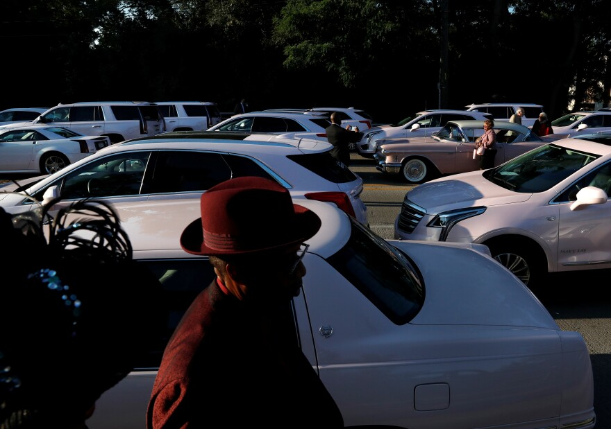 """More than 100 pink Cadillacs are parked outside the church to honor Franklin, who in """"Freeway of Love"""" sang: """"We goin' ridin' on the freeway of love in my pink Cadillac."""""""