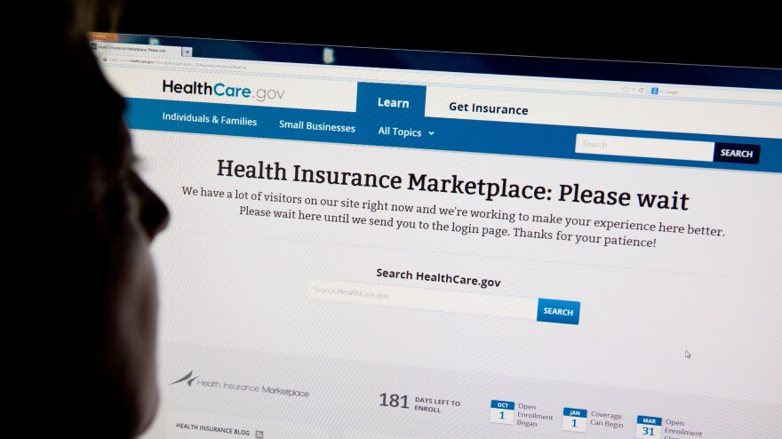 A woman looks at the HealthCare.gov insurance exchange site on Oct. 1 in Washington, D.C.