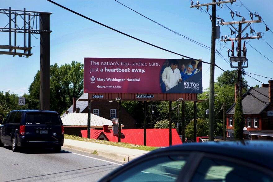 A Mary Washington Hospital billboard greets people coming into town.