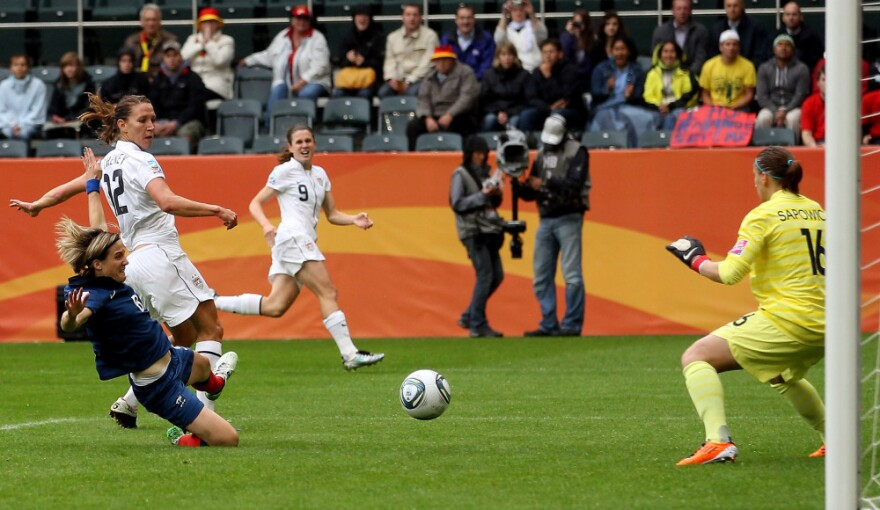 Lauren Cheney of the U.S. scores an early goal after a low, hard pass from Heather O'Reilly, during the FIFA Women's World Cup 2011 semifinal match with France.