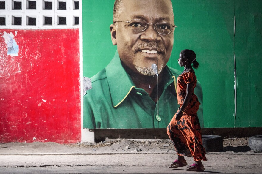 "Candidate John Magufuli looks out from an election billboard in Dar es Salaam, Tanzania's largest city. The former teacher and chemist took office as president in November and has pledged to fight corruption. His nickname: ""the bulldozer."""