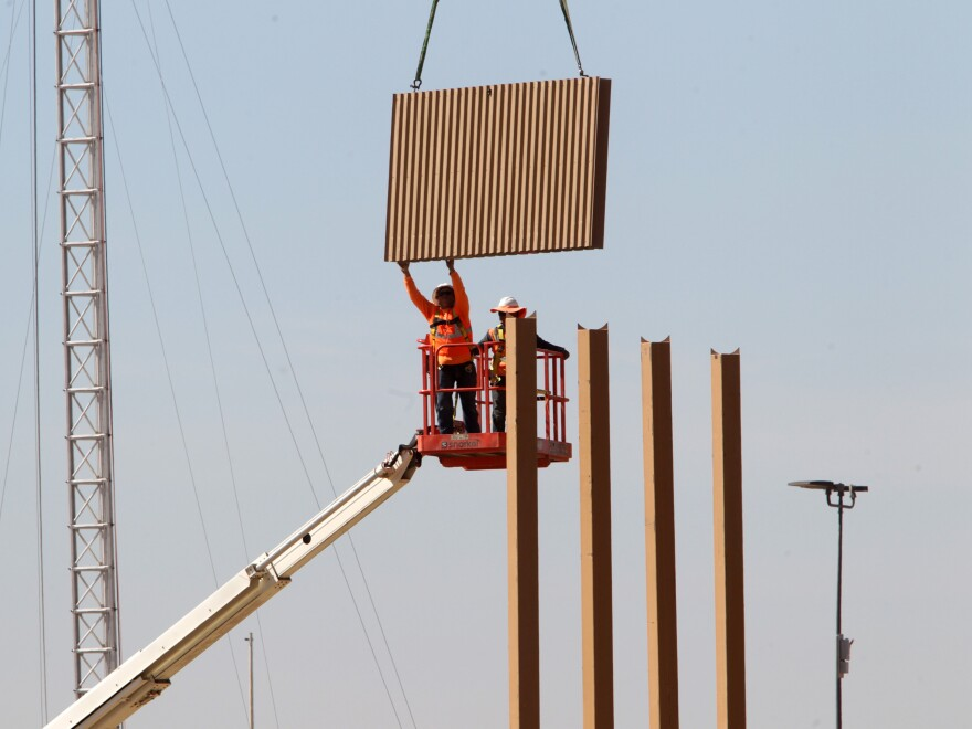 Border wall prototypes are being erected on Otay Mesa in San Diego County, just north of the U.S.-Mexico border.